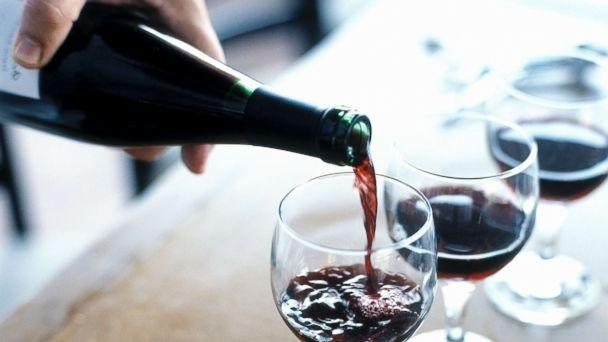 PHOTO: A person is pictured pouring red wine. (Joe Vaughn/Getty Images)
