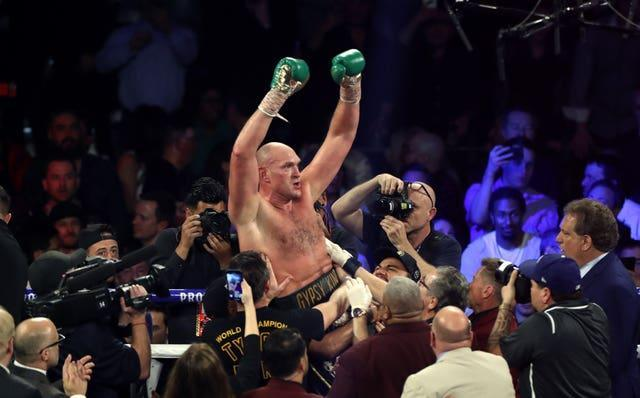 Fury, centre, is the WBC heavyweight champion (Bradley Collyer/PA)