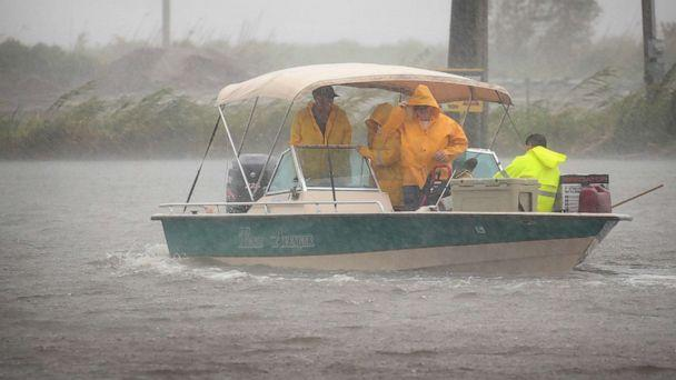 PHOTO: Boaters head out in a driving rain to survey damage to their fish camps in the wake of Hurricane Barry, July 14, 2019, in Myrtle Grove, La. (Scott Olson/Getty Images)