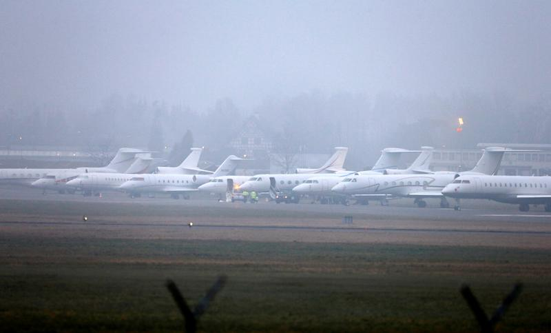 Passenger jets are parked at the Swiss Air Force base, which is used for arrivals and departures of participants of the the annual meeting of the World Economic Forum (WEF) in Davos, during foggy weather in Duebendorf, Switzerland January 24, 2020. REUTERS/Arnd Wiegmann