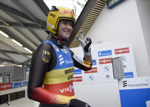 Natalie Geisenberger of Germany reacts after she placed second in a women's race at the Luge World Cup event in Sigulda, Latvia, Sunday, Jan. 10, 2021. (AP Photo/Roman Koksarov)