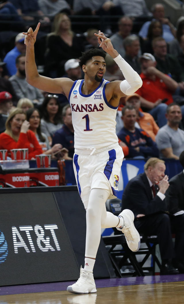 Kansas forward Dedric Lawson (1) celebrates after scoring a three-point basket against Northeastern in the first half during a first round men's college basketball game in the NCAA Tournament, Thursday, March 21, 2019, in Salt Lake City. (AP Photo/Rick Bowmer)