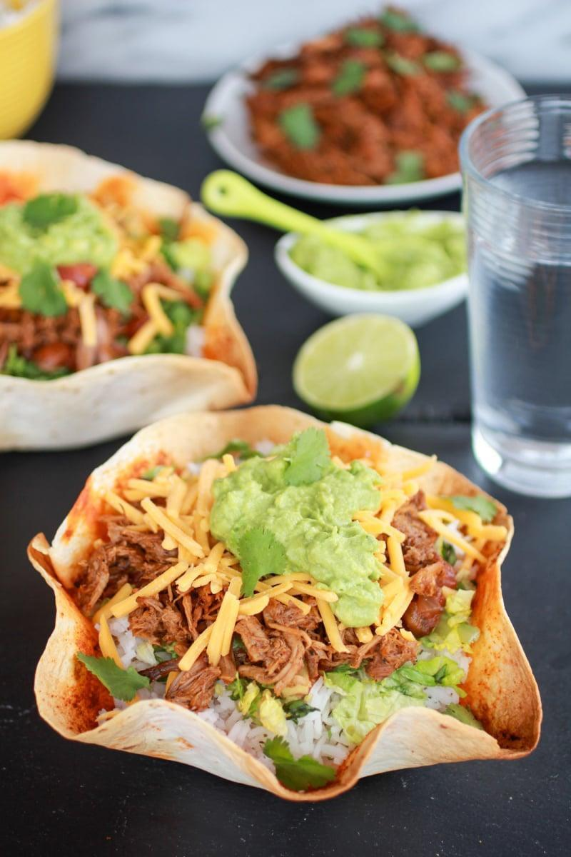 "<p><strong>Get the recipe</strong>: <a href=""http://www.halfbakedharvest.com/crockpot-carnitas-tortilla-burrito-bowl/"" class=""link rapid-noclick-resp"" rel=""nofollow noopener"" target=""_blank"" data-ylk=""slk:slow-cooker carnitas burrito bowls"">slow-cooker carnitas burrito bowls</a></p>"
