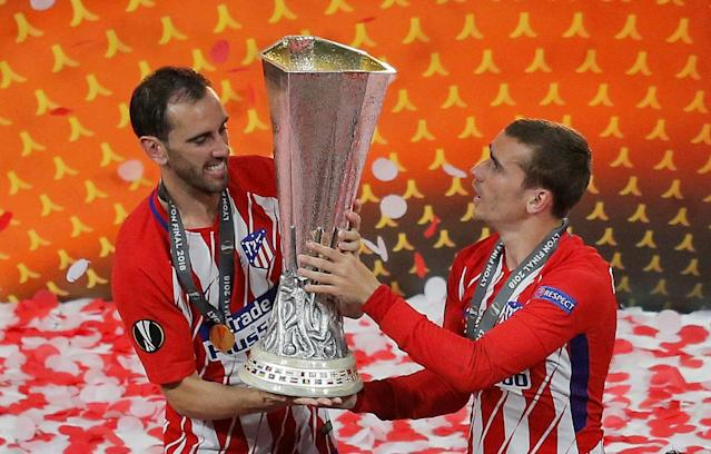 Soccer Football - Europa League Final - Olympique de Marseille vs Atletico Madrid - Groupama Stadium, Lyon, France - May 16, 2018 Atletico Madrid's Diego Godin and Antoine Griezmann celebrate with the trophy after winning the Europa League REUTERS/Vincent Kessler
