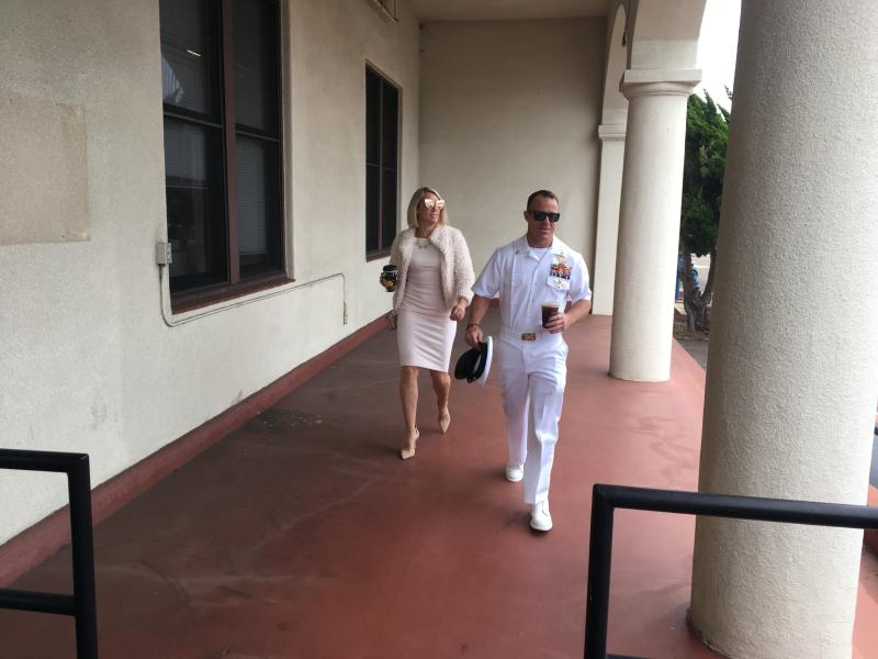 Navy Special Operations Chief Edward Gallagher, right, walks with his wife, Andrea Gallagher as they arrive to military court on Naval Base San Diego, Monday, June 24, 2019, in San Diego. Trial continues in the court-martial of the decorated Navy SEAL, who is accused of stabbing to death a wounded teenage Islamic State prisoner and wounding two civilians in Iraq in 2017. He has pleaded not guilty to murder and attempted murder, charges that carry a potential life sentence. (AP Photo/Julie Watson)