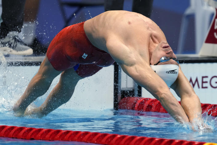 Ryan Murphy of the United States starts in a heat of the men's 200-meter backstroke at the 2020 Summer Olympics, Wednesday, July 28, 2021, in Tokyo, Japan. (AP Photo/Martin Meissner)
