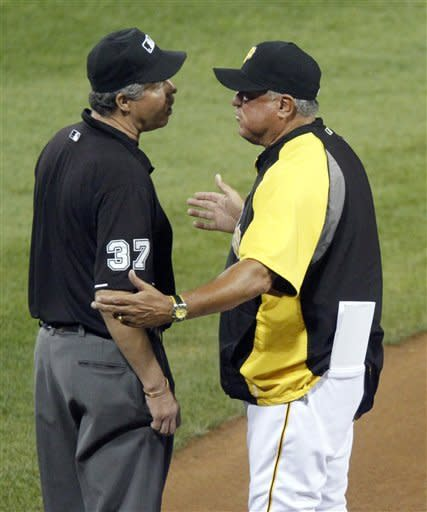 Pittsburgh Pirates manager Clint Hurdle, right, argues with third base umpire Gary Darling after Darling called Chicago Cubs' Brett Jackson safe in the sixth inning of a baseball game Friday, Sept. 7, 2012, in Pittsburgh. Hurdle was ejected from the game. (AP Photo/Keith Srakocic)