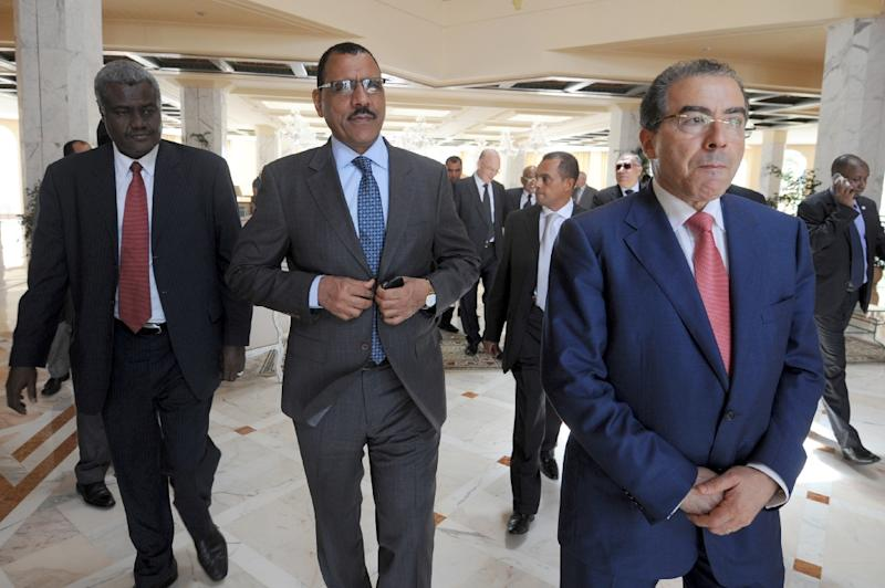 File photo shows then Nigerien Minister of Foreign Affairs Mohamed Bazoum (C) with Tunisian counterpart Mongi Hamdi (R) and Chadian counterpart Faki Mahamat (L) in the Tunisian city of Hammamet on July 14, 2014