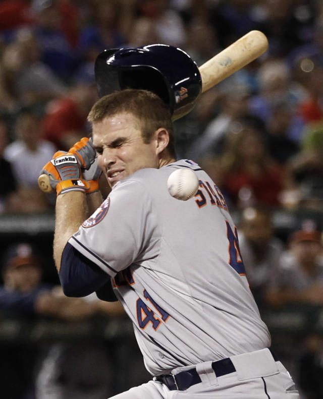 Houston Astros' Max Stassi is hit in the face by a pitch thrown by Texas Rangers reliever Tanner Scheppers during the eighth inning of a baseball game, Wednesday, Aug. 21, 2013, in Arlington, Texas. (AP Photo/Jim Cowsert)