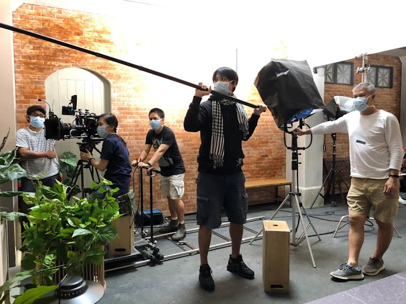 """A film crew on a set wearing masks and practising physical distancing in Singapore before the government's """"circuit breaker"""" measures against the spread of the coronavirus kicked in on 7 April 2020. (Photo: Courtesy of SAMPP)"""