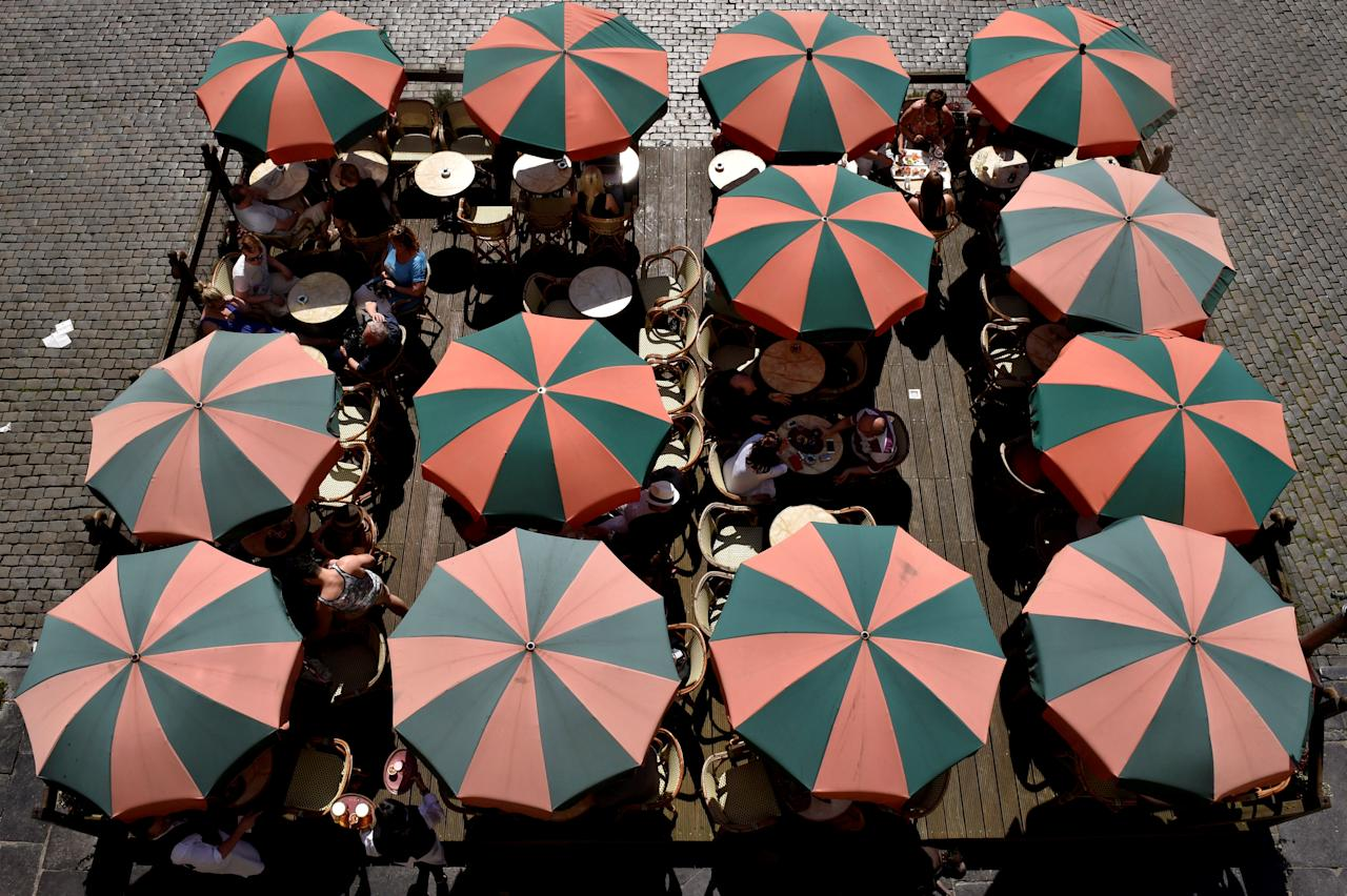 FILE PHOTO: Terrace umbrellas are displayed during a hot and sunny day at the Grand Place in Brussels, Belgium, May 8, 2016. REUTERS/Eric Vidal/File Photo