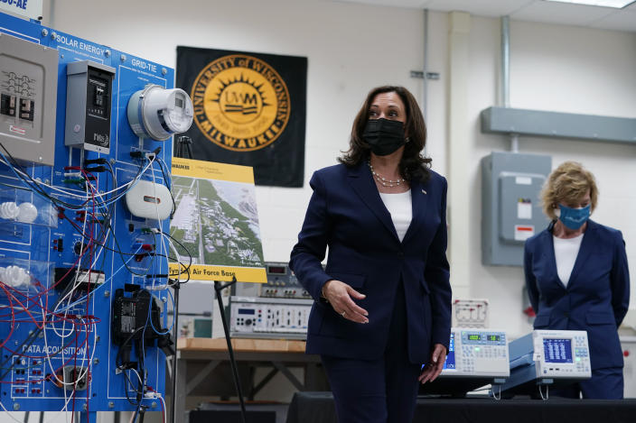 FILE - In this May 4, 2021, file photo Vice President Kamala Harris tours clean energy laboratories with Sen. Tammy Baldwin, D-Wis., at the University of Wisconsin-Milwaukee during a visit to promote President Joe Biden's $2 trillion jobs and infrastructure plan, in Milwaukee. President Joe Biden's hope of pouring billions of dollars into green infrastructure investments is running into the political obstacle of winning over Republican votes. Biden wants his infrastructure package to include ways to fight climate change. (AP Photo/Susan Walsh, File)