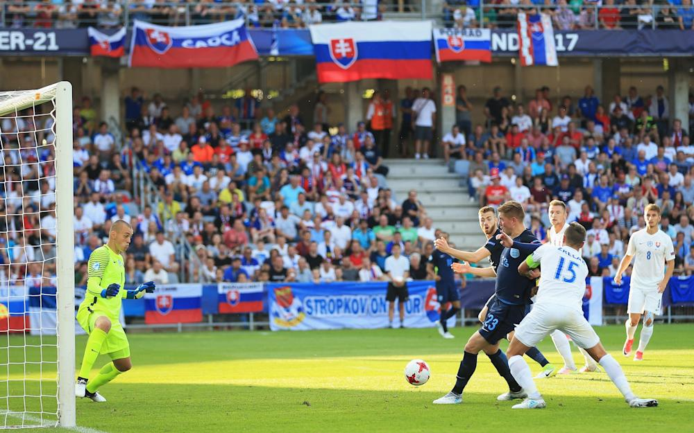 Alfie Mawson of England shoots on the way to scoring his team's opening goal - Credit: GETTY IMAGES