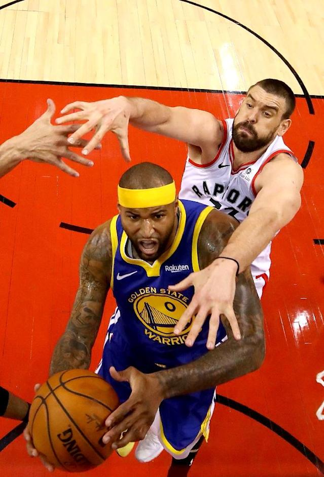 Golden State's DeMarcus Cousins goes up for a shot against Toronto's Marc Gasol in game five of the NBA Finals (AFP Photo/Gregory Shamus)