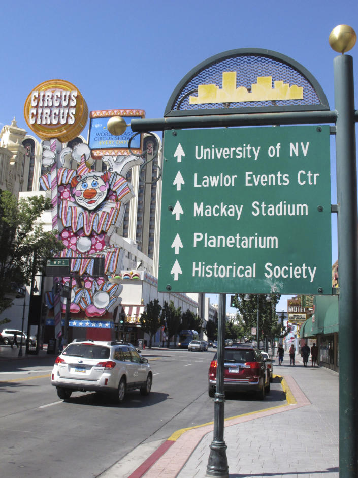 This photo taken Aug. 19, 2019 shows the Circus Circus casino's famous clown in downtown Reno, Nev., a block from the casino-hotel tower where about 1,300 University of Nevada students will live this school year. A gas explosion in July shut down indefinitely the school's two largest residence halls on campus a half-mile away. (AP Photo/Scott Sonner)