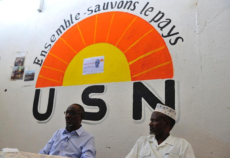Djiboutian opposition presidential candidate of the Union for National Salvation (USN) Omar Elmi Khaireh (L) speaks to AFP during an interview in Djibouti (AFP Photo/Simon Maina)