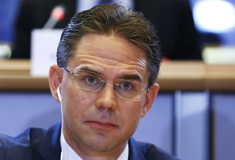 European Jobs, Growth, Investment and Competitiveness Commissioner-designate Katainen looks on before addressing the European Committee on Economic and Monetary Affairs at the EU Parliament in Brussels