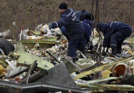 Local workers work on the Malaysia Airlines flight MH17 wreckage at the site of the plane crash near the village of Hrabove (Grabovo) in Donetsk region, eastern Ukraine November 20, 2014. REUTERS/Antonio Bronic