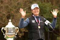 Unmasked: Kim A Lim celebrates with the US Open trophy