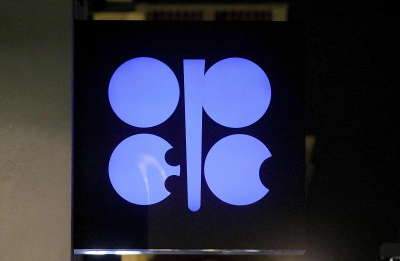 The advertising label of the Organization of the Petroleum Exporting Countries, OPEC, shines at their headquarters in Vienna, Austria, Austria, Thursday, Dec. 5, 2019. The countries that make up the OPEC oil-producing cartel are meeting Thursday to decide whether to cut production in order to support the price of fuel and energy around the world.(AP Photo/Ronald Zak)