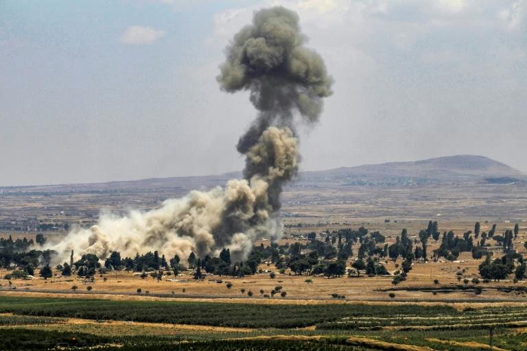 A picture taken from the Israeli-annexed Golan Heights shows smoke rising across the border area in Syria's southwestern Quneitra province on July 22, 2018