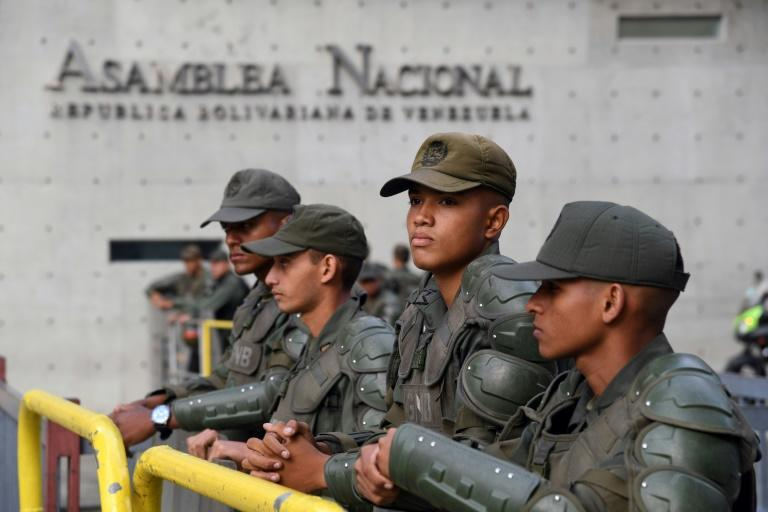 Members of Venezuela's National Guard man a barricade outside of the National Assembly in Caracas, on January 5, 2020; opposition leader Juan Guaido was prevented from entering for a key vote
