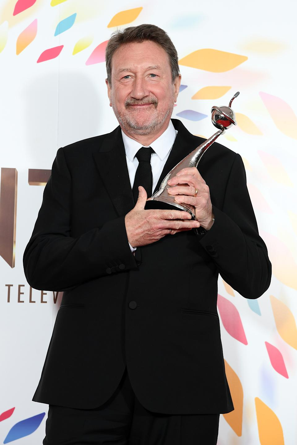 Steven Knight winner of the best Drama Award for Peaky Blinders pose in the winners room during the National Television Awards 2020 at The O2 Arena on January 28, 2020 in London, England. (Photo by Mike Marsland/WireImage)