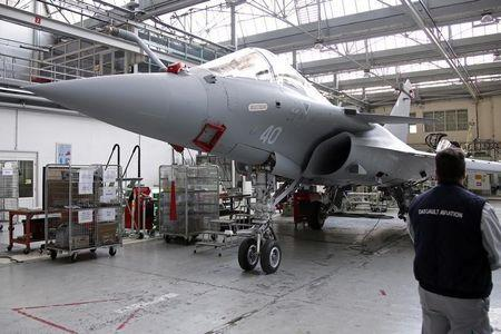 A worker looks at a Rafale jet fighter as he works on the assembly line in the factory of French aircraft manufacturer Dassault Aviation in Merignac near Bordeaux