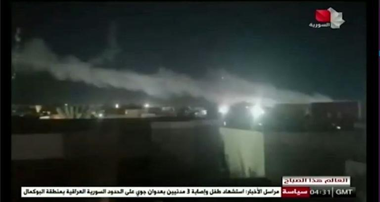 An image grab from Syrian state television shows smoke billowing over a facility used by Iran-backed groups following US air strikes on the Syrian-Iraqi border