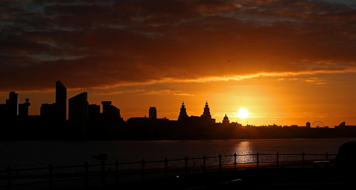 The sun rises behind the Liver Building over the Liverpool waterfront as temperatures dropped below freezing for many parts of the country.