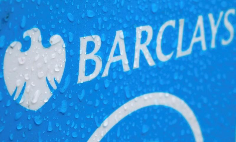 File photograph of raindrops on the logo of a rental bicycle sponsored by Barclays in London