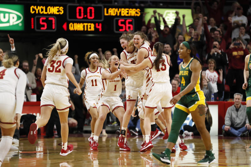 Iowa State players celebrate as Baylor guard Te'a Cooper (4) walks off the court at the end of an NCAA college basketball game, Sunday, March 8, 2020, in Ames, Iowa. (AP Photo/Charlie Neibergall)
