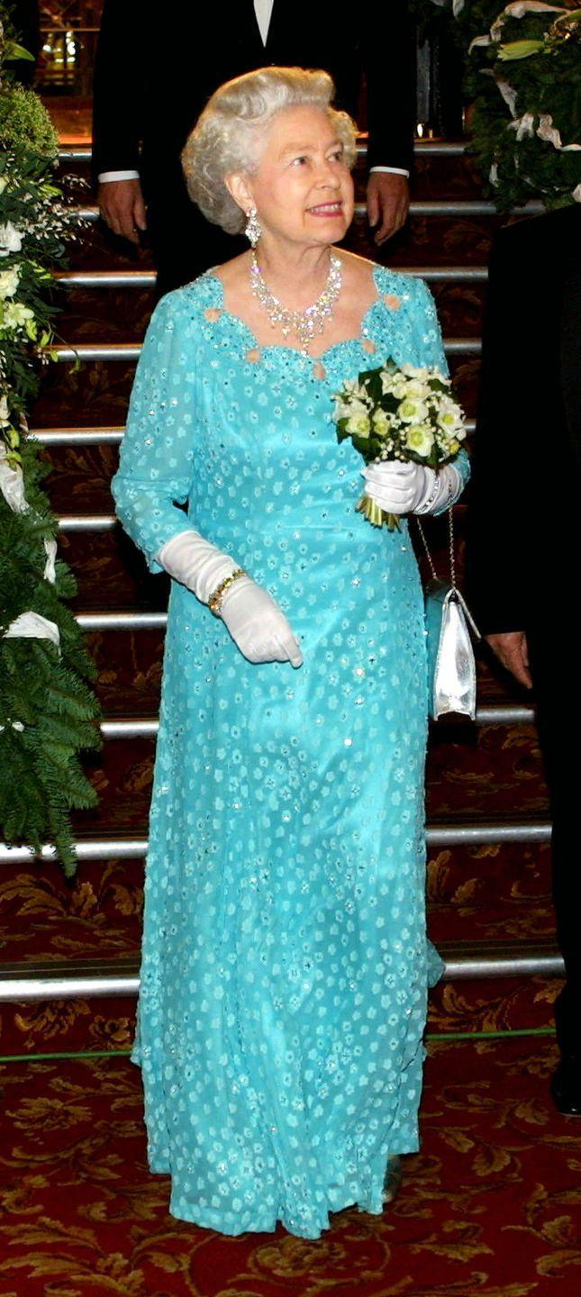 <p>The vibrant blue dress Queen Elizabeth wore for the Royal Variety Show in 2001 perfectly matches the hue of Jasmine's outfit. The Queen even accessorized with bold statement earrings, just like the Arabian Princess. </p>