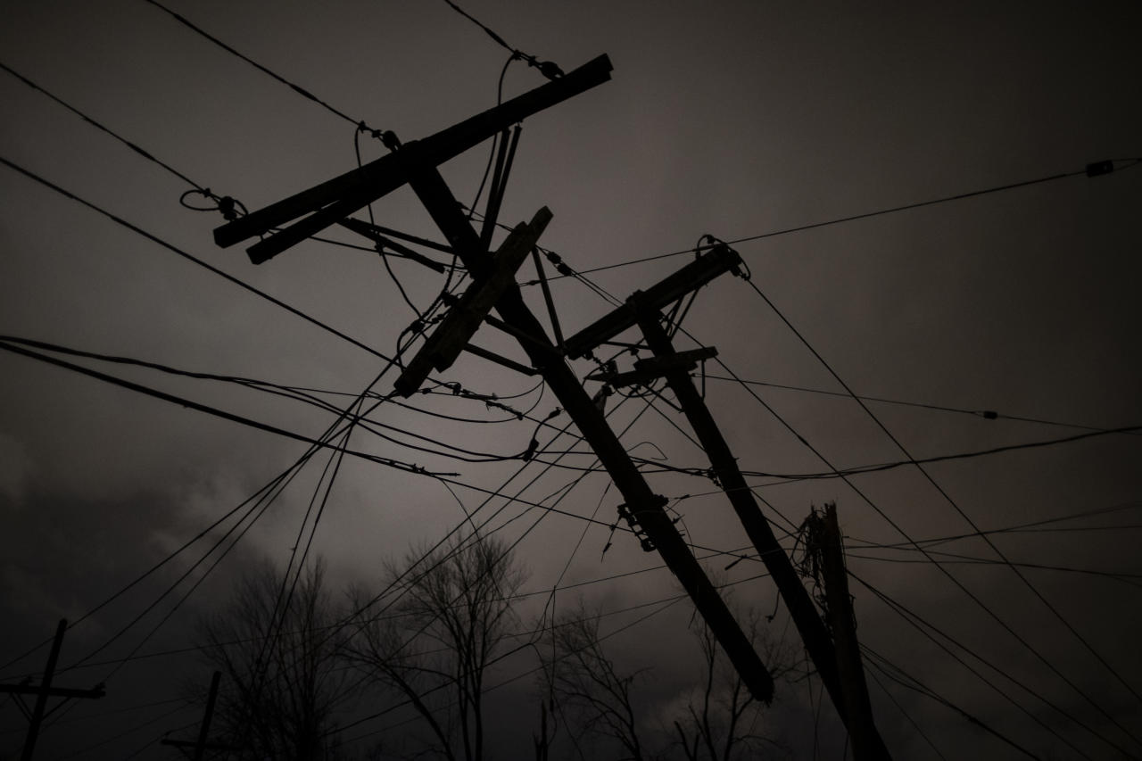 Damaged utility poles and lines hang above Underwood St. on March 3, 2020 in Nashville, Tennessee. A tornado passed through Nashville just after midnight leaving a wake of damage in its path including two people killed in East Nashville. (Brett Carlsen/Getty Images)