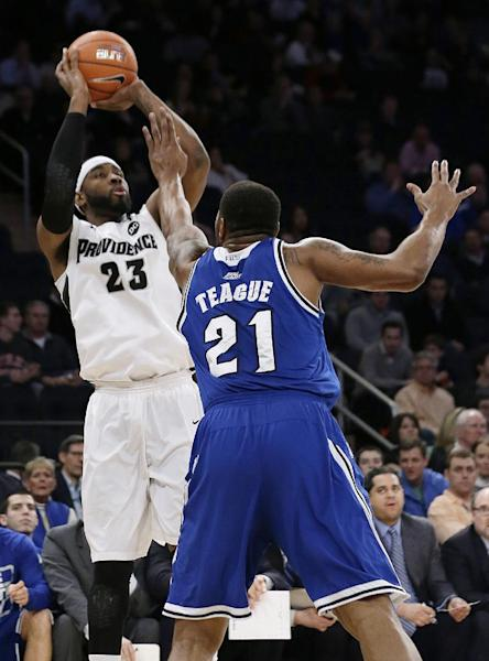 Providence's LaDontae Henton (23) shoots over Seton Hall's Eugene Teague (21) during the first half of an NCAA college basketball game in the semifinals of the Big East Conference men's tournament Friday, March 14, 2014, at Madison Square Garden in New York. (AP Photo/Frank Franklin II)