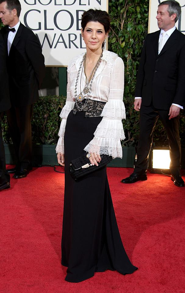 Golden Globe Awards  Grade: D+    The black skirt is nice, the lace belt is cool, but the pirate-sleeved top of Marisa's Oscar de la Renta ensemble is atrocious. Her excessive jewelry and slump-shoulder stance only make her look more out of place.