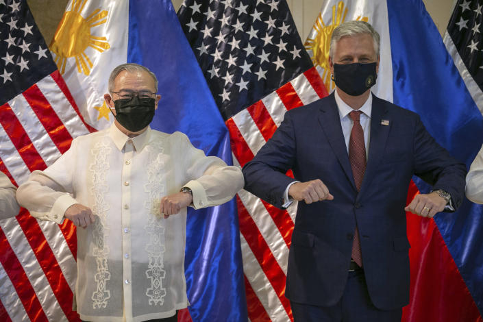U.S. National Security Advisor Robert O'Brien, right, and Philippine Foreign Secretary Teodoro Locsin Jr. elbow bump after the turnover ceremony of defense articles at the Department of Foreign Affairs in Pasay City, Metro Manila, Philippines, Monday, Nov. 23, 2020. (Eloisa Lopez/Pool Photo via AP)