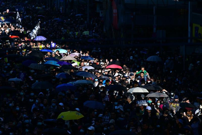 'We Have to Keep Fighting.' Thousands of Hongkongers March on Six-Month Protest Anniversary