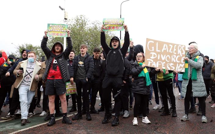 Manchester United fans outside the ground during a protest against the Glazer family, - PA