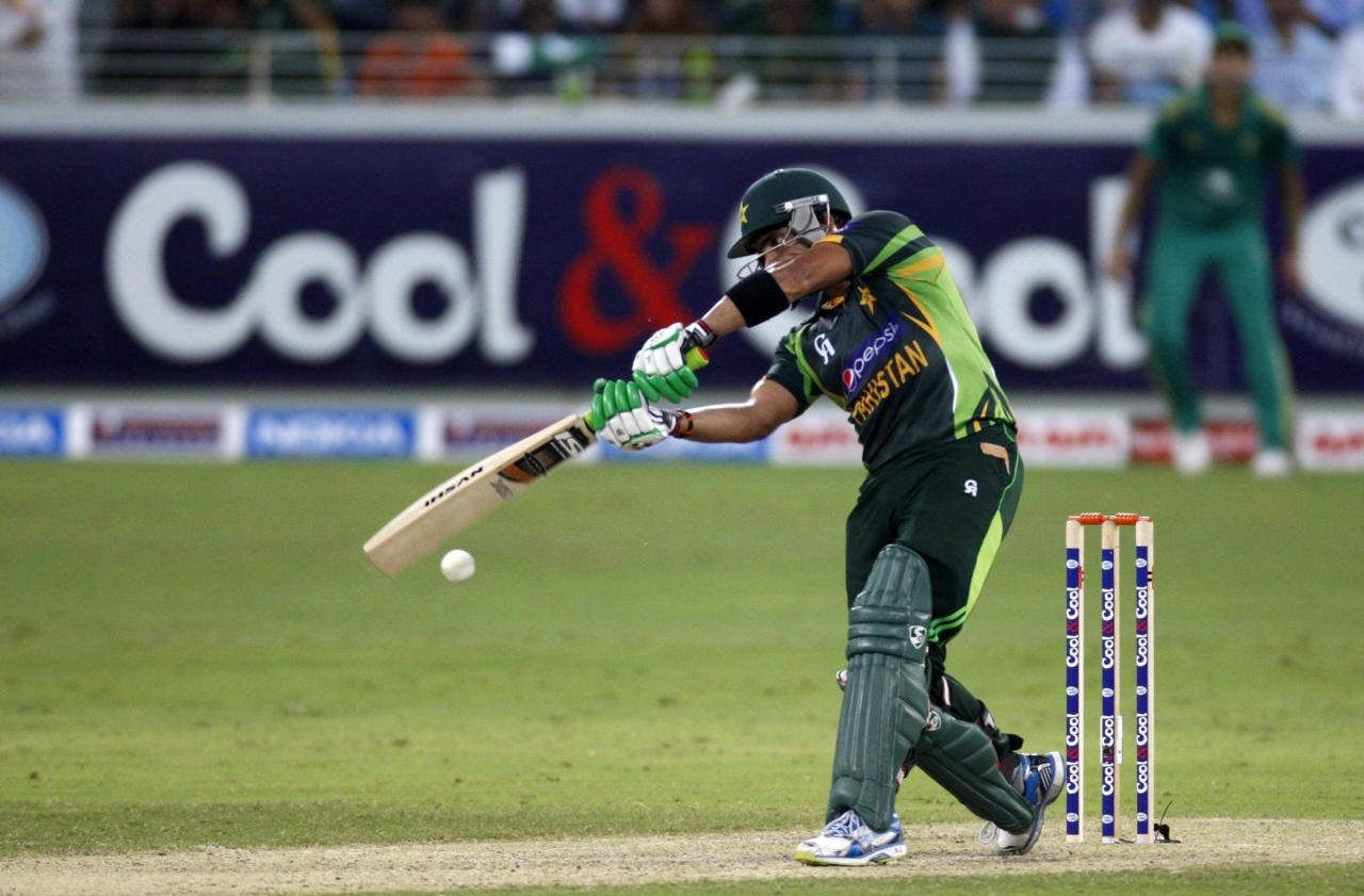 Pakistan's Umar Akmal plays a shot during their first Twenty20 international cricket match against South Africa in Dubai November 13, 2013. REUTERS/Nikhil Monteiro (UNITED ARAB EMIRATES - Tags: SPORT CRICKET)
