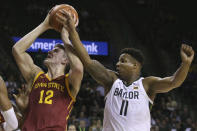 Iowa State forward Michael Jacobson (12) is fouled by Baylor guard Mark Vital (11) during the first half of an NCAA college basketball game Wednesday Jan. 15, 2020, in Waco, Texas. (AP Photo/Jerry Larson)