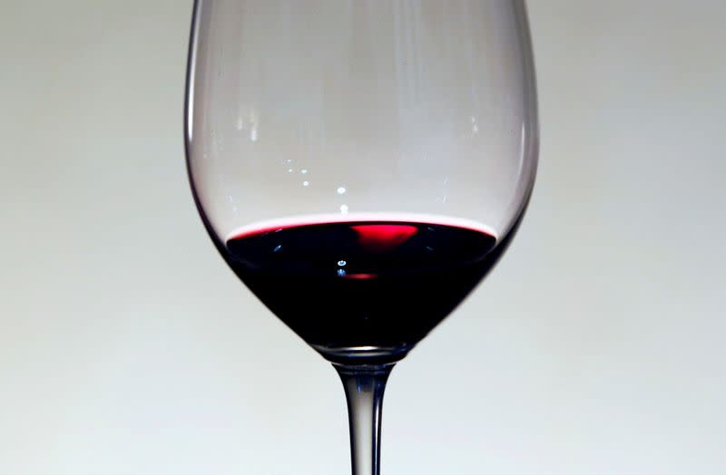 FILE PHOTO: A glass of red wine is displayed at the Chateau La Louviere in Leognan