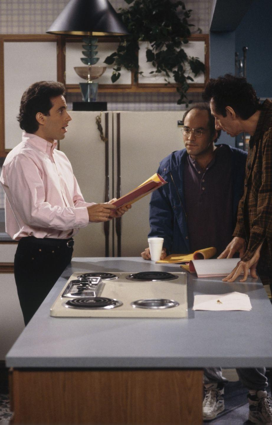 <p>Seinfeld runs through a scene with guest stars Jeremy Piven (left) and Larry Hankin (right). </p>