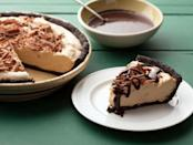 """<p>The Neelys' frozen version of peanut butter pie is topped with a homemade hot fudge sauce. Add chopped peanuts and whippe cream if you like, too. <a href=""""http://www.foodnetwork.com/recipes/patrick-and-gina-neely/peanut-butter-pie-recipe.html"""" rel=""""nofollow noopener"""" target=""""_blank"""" data-ylk=""""slk:Get the Neelys' Peanut Butter Pie recipe at FoodNetwork.com."""" class=""""link rapid-noclick-resp""""><b>Get the Neelys' Peanut Butter Pie recipe at FoodNetwork.com</b>.</a> (<i>Photo: Food Network)</i></p>"""