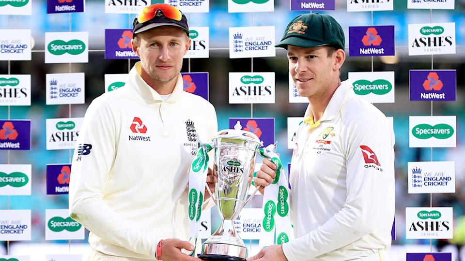 Pictured here, England captain Joe Root and Aussie counterpart Tim Paine pose with the Ashes trophy.