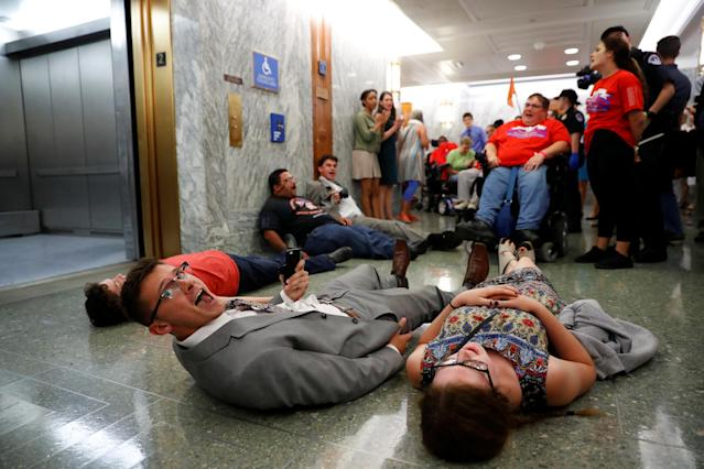 <p>Demonstrators like on the ground as the Senate Finance Committee holds a hearing on the latest Republican Effort to repeal and replace the Affordable Care Act on Capitol Hill in Washington, U.S. September 25, 2017. (Photo: Aaron P. Bernstein/Reuters) </p>