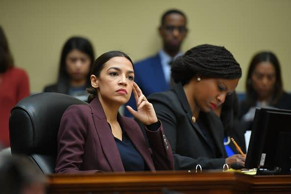 US Congresswoman Alexandria Ocasio-Cortez(D-NY) listens as Michael Cohen, attorney for President Trump, testifies before the House Oversight and Reform Committee in the Rayburn House Office Building on Capitol Hill in Washington, DC on Feb. 27, 2019. | Mandel Ngan—AFP/Getty Images