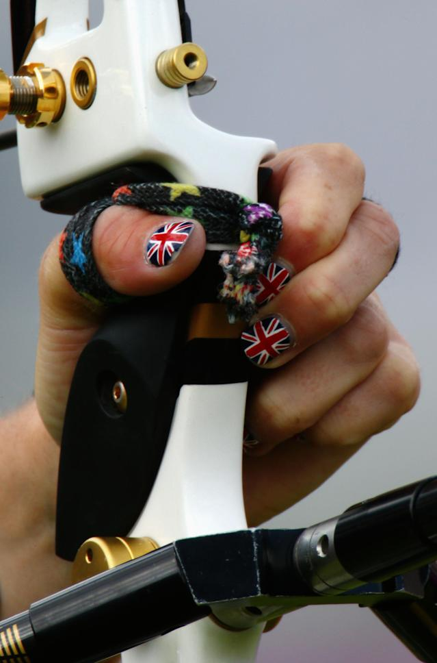 LONDON, ENGLAND - JULY 29: A detail view of the hand and nail varnish of Naomi Folkard of Great Britain in action during the Women's Team Archery Eliminations match between Great Britain and Russia on Day 2 of the London 2012 Olympic Games at Lord's Cricket Ground on July 29, 2012 in London, England. (Photo by Paul Gilham/Getty Images)