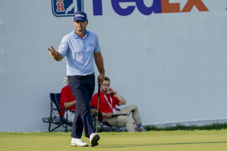 Ryan Armour acknowledges the crowd after sinking a putt for a birdie and tying for the lead on the 18th hole during the second round of the 3M Open golf tournament in Blaine, Minn., Friday, July 23, 2021. (AP Photo/Craig Lassig)