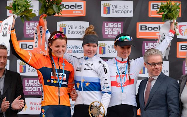<span>Anna van der Breggen is flanked by team-mate Lizzie Deignan (left) and Katarzyna Niewiadoma after winning the first ever women's edition of Liège-Bastogne-Liège</span> <span>Credit: GETTY IMAGES </span>